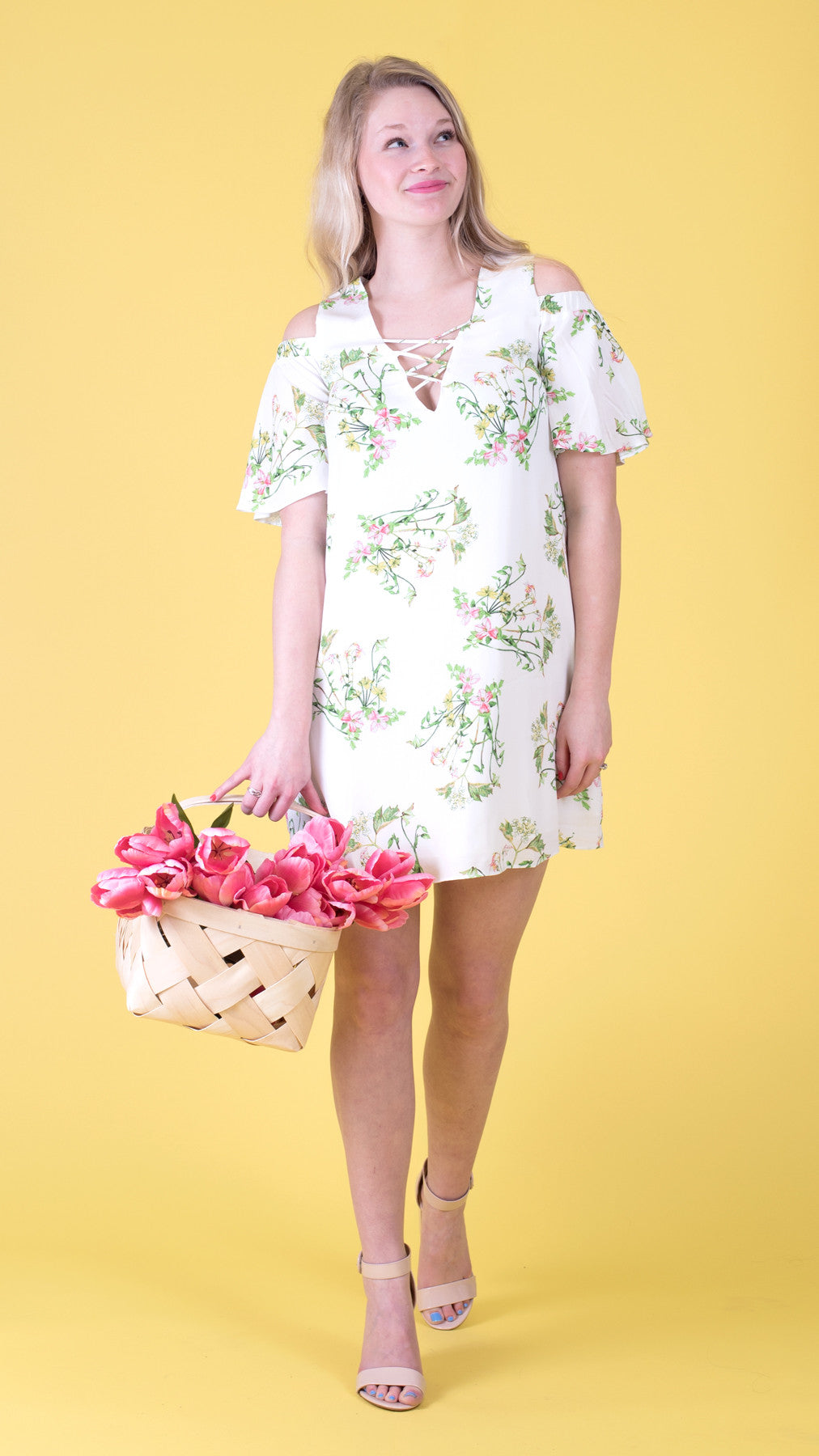floral dress with cold shoulder and flutter sleeves, pastel flowers on a white background
