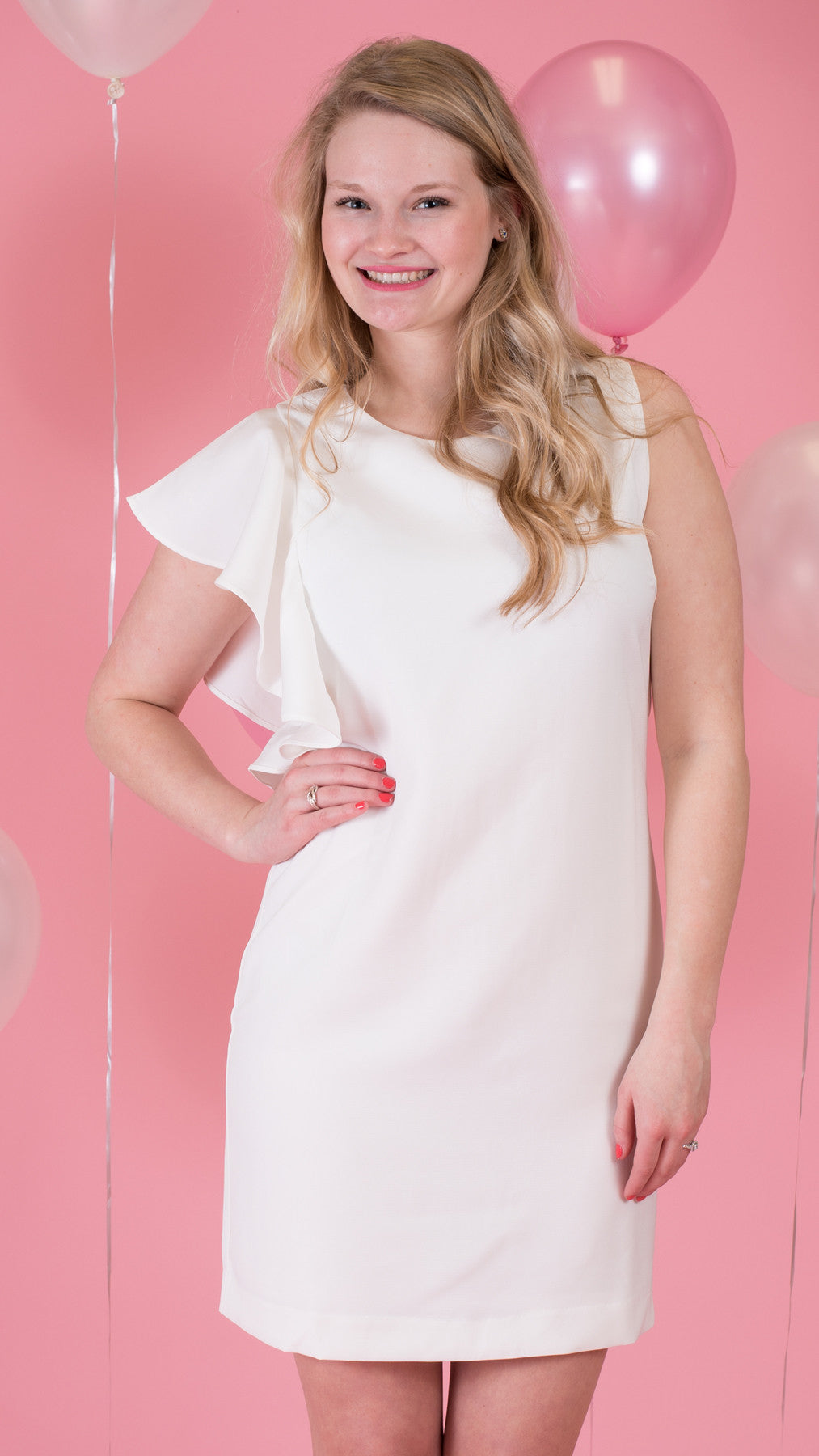 White sleeveless sheath dress with ruffle on one arm