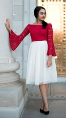 Cream color tulle skirt, midi length, paired with red lace off the shoulder top with bell sleeves.