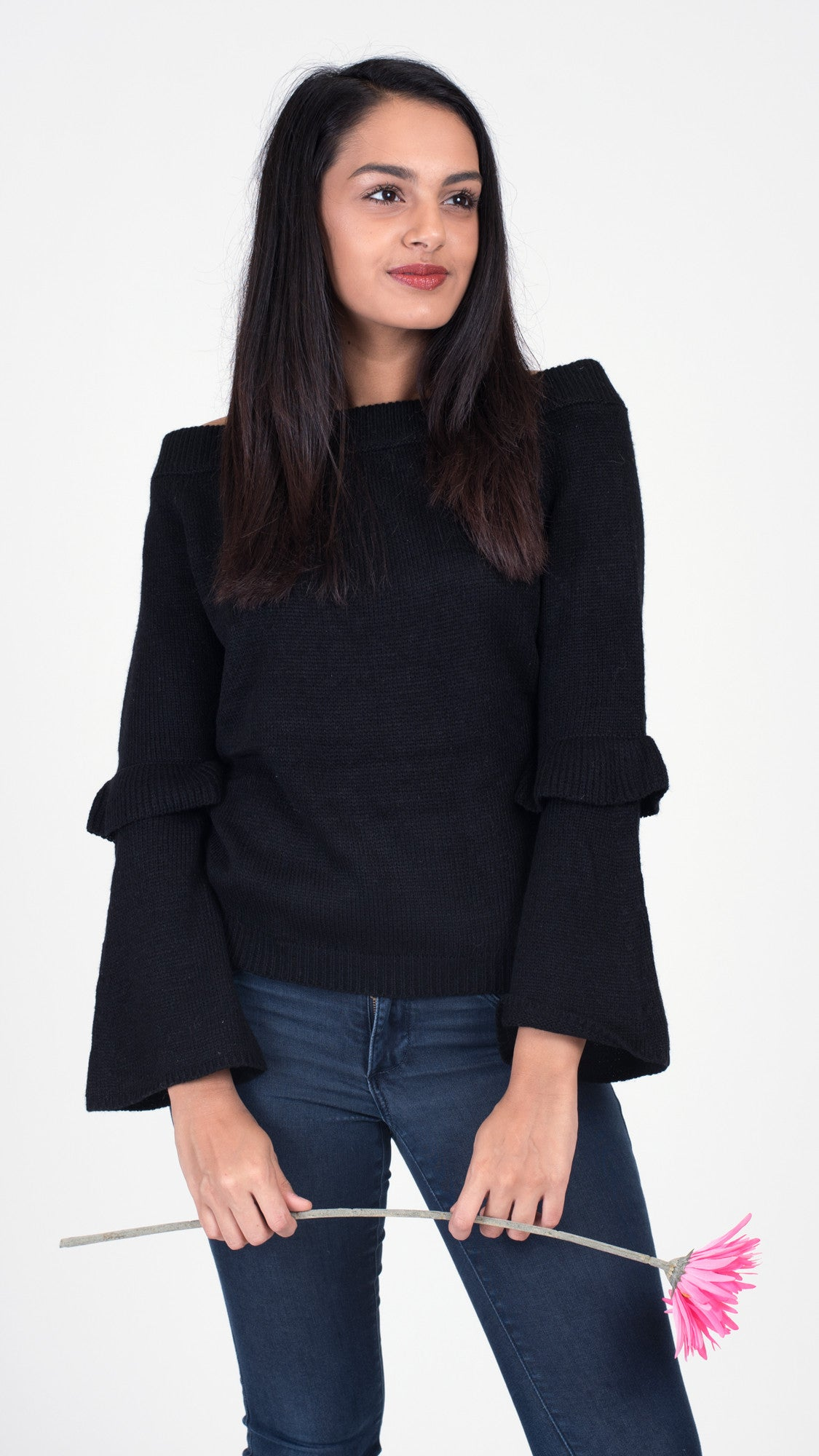 black off the shoulder sweater with bell sleeves and a ruffle at the elbow