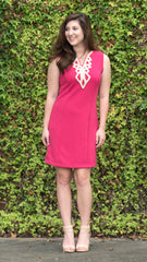 Hot pink fitted dress with gold trim at neckline