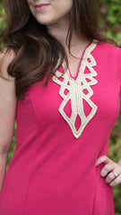 hot pink fitted dress with gold trim at neckline - close up of trim