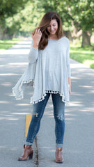 heather grey swing top with uneven hemline and tassels