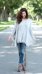 heathered grey swing top with tassels at hemline
