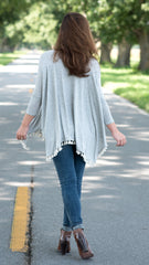 heather gray swing top with tassels at hemline and 3/4 length sleeves - back view