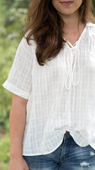 white top with short sleeves and lace up front - close view