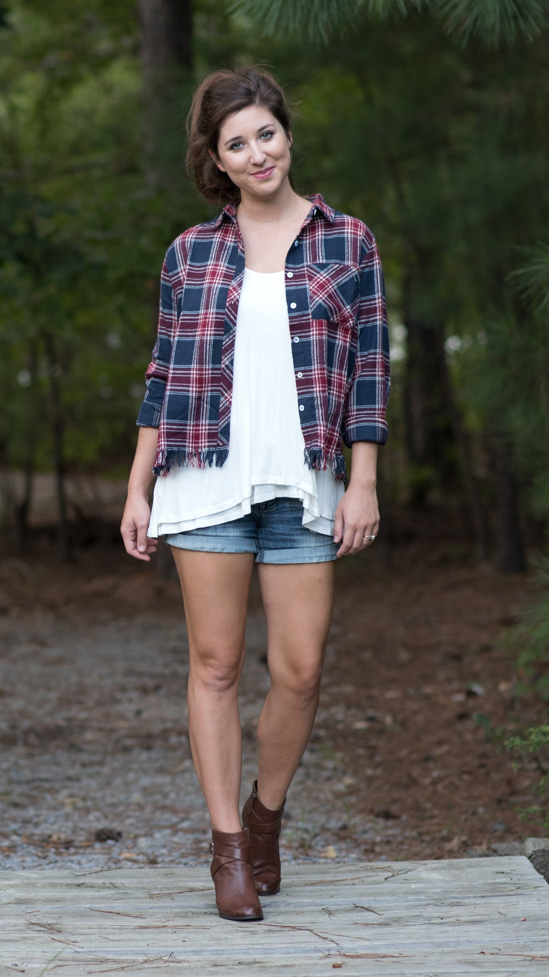 red and blue plaid shirt with fringe at hem