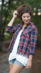 red and blue plaid top with fringed hem