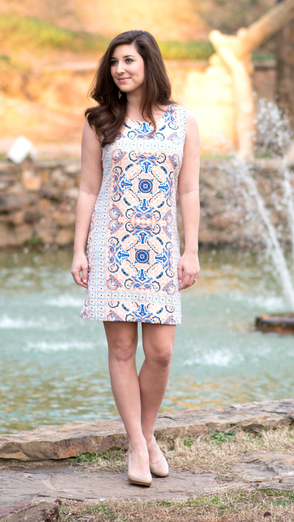 peach and blue patterned sheath dress