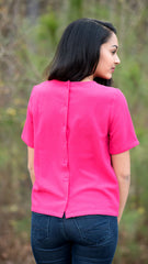 Hot pink top from Buddy Love with buttons down the back