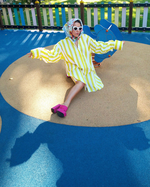Cátia wears Marques'Almeida Yellow Stripes Oversized Shirt and Karen Mabon Healthy Scarf.