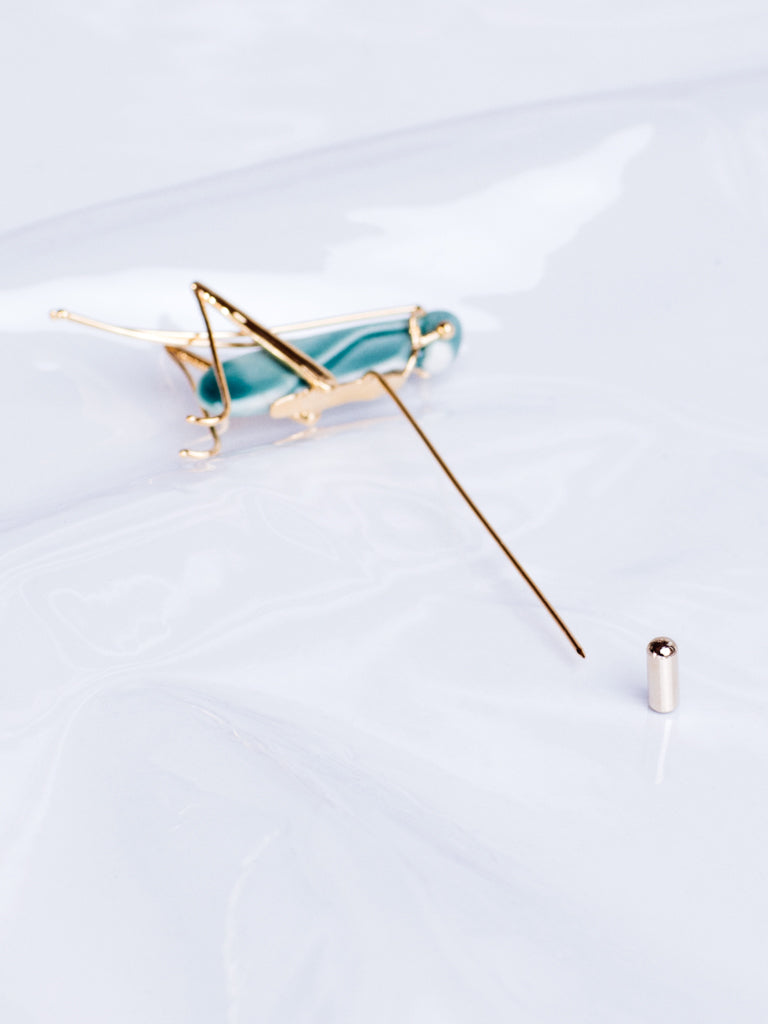 ANDRESGALLARDO Handcrafted Porcelain Grasshopper and Gold Plated Pin