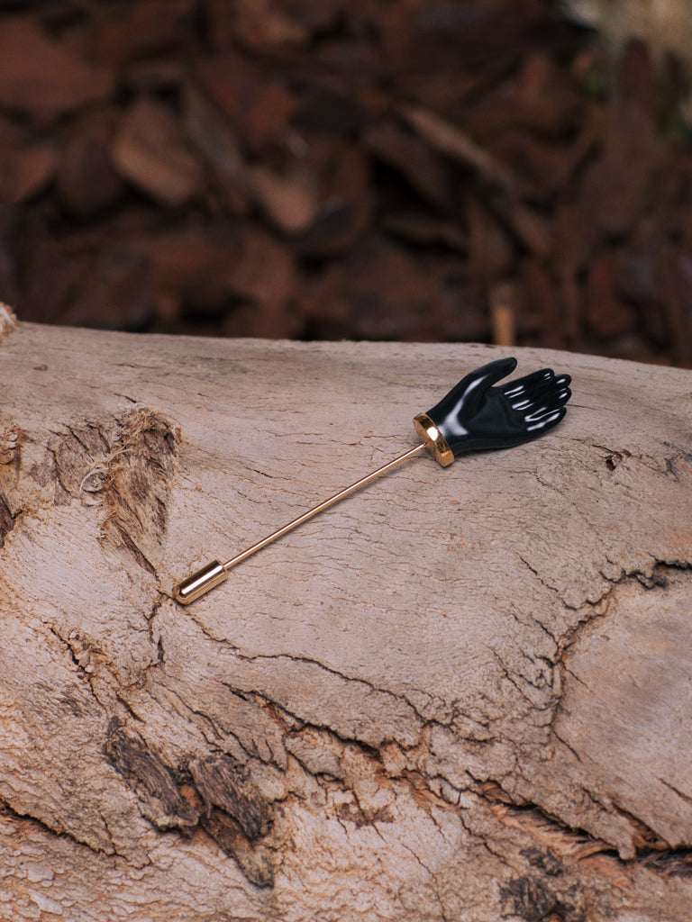 ANDRESGALLARDO  Handcrafted Black Painted Porcelain Little Hand and 18K Gold Plated Pin