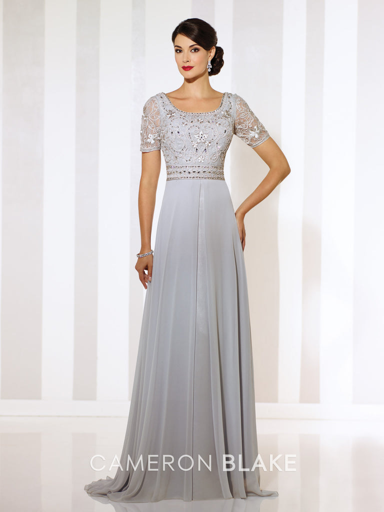 Short sleeve chiffon A-line gown.