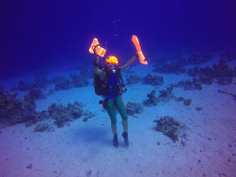 Ulli Herold from Ullis Diving in Egypt dancing underwater in her Truli Wetsuits