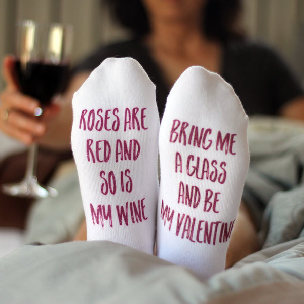This is an image of Valentine's Day wine-themed bottoms up custom printed socks.