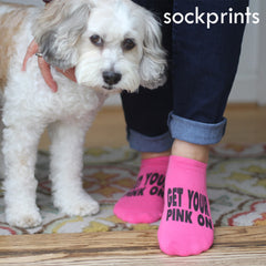 "This is an image of customized ""Get Your Pink On"" no show fuchsia pink socks and a dog."