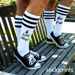"This is an image of customized ""Witch Please"" striped knee high socks."