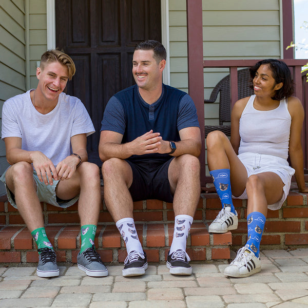 This is an image of three people wearing full print photo pet socks.