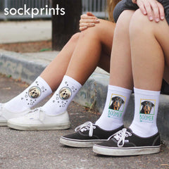 This is an image of two people wearing two pairs of custom printed pet socks.