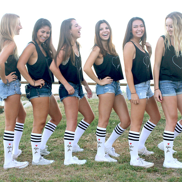 This is an image of a group of girls posing and wearing the sorority Alpha Phi knee high custom printed socks.