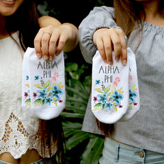 This is an image of sorority Alpha Phi floral watercolor custom printed socks.