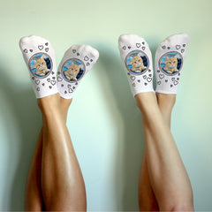 This is an image of white no-show socks with a photo of a cat and hearts.