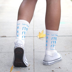 This is an image of Let Them Play white crew socks.