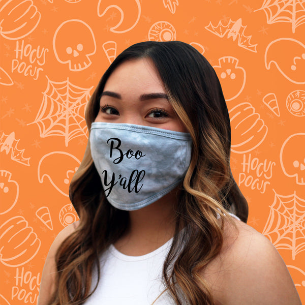 This is an image of a girl wearing the Boo Y'all Halloween 2020 Tie Dyed Cotton Face Mask.