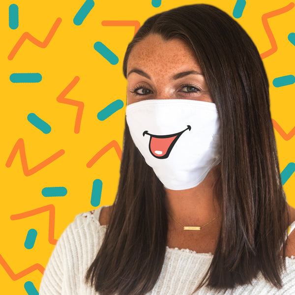 This is an image of a woman wearing the Sticking Your Tongue Out Printed on a 100% Cotton Face Covering.