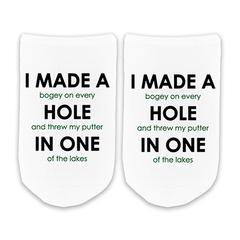 This is an image of the Hole In One Funny No-Show Golf Socks.