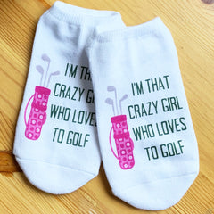 This is an image of I'm That Crazy Girl Who Loves To Golf socks.