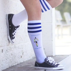 This is an image of Let Them Play royal striped knee high socks.