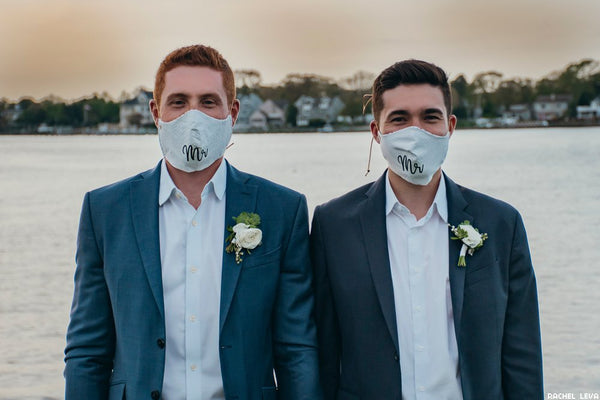This is an image of a couple wearing custom printed Mr. and Mr. wedding face masks.