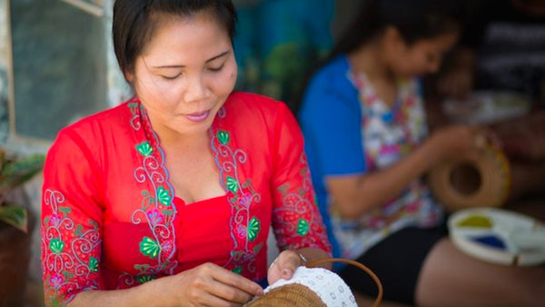 This is an image of two women working on a project funded by Kiva.