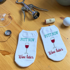This is an image of Putt Now Wine Later golf socks.