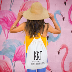 This is an image of a girl wearing the Sorority Name with Boho Design Drawstring Bag.