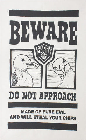 Evil Seaside Seagull tea towel