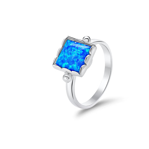 Sterling silver synthetic blue opal ring