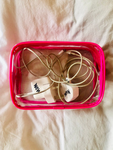 Clear makeup bag used to organise computer cables