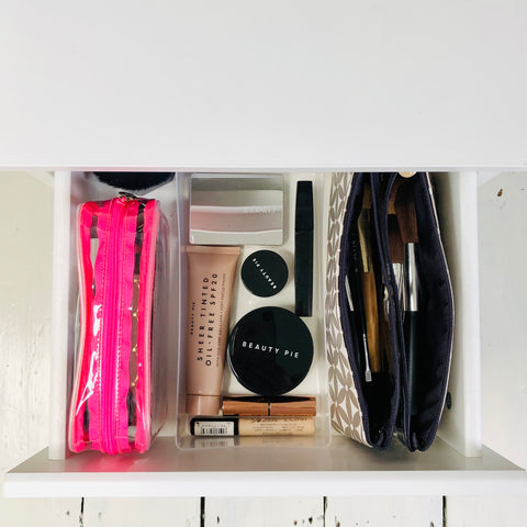Perfectly organised makeup drawer using folding makeup bag and a clear makeup bag