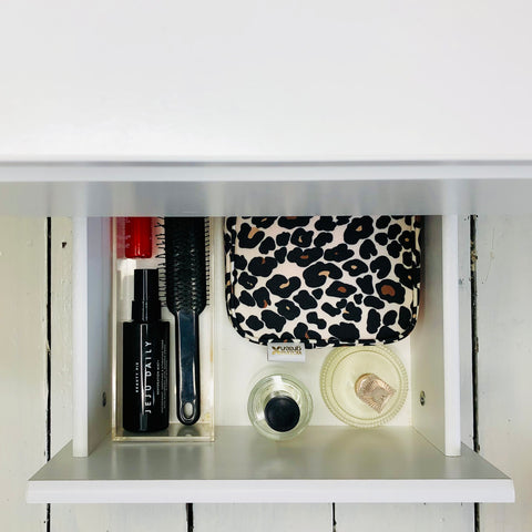 Dressing table organised using makeup bags and beauty bags