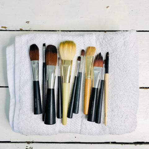 clean makeup brushes ready to go back into a clean makeup bag