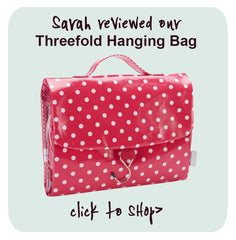 folding hanging wash bag in red polka dot pattern