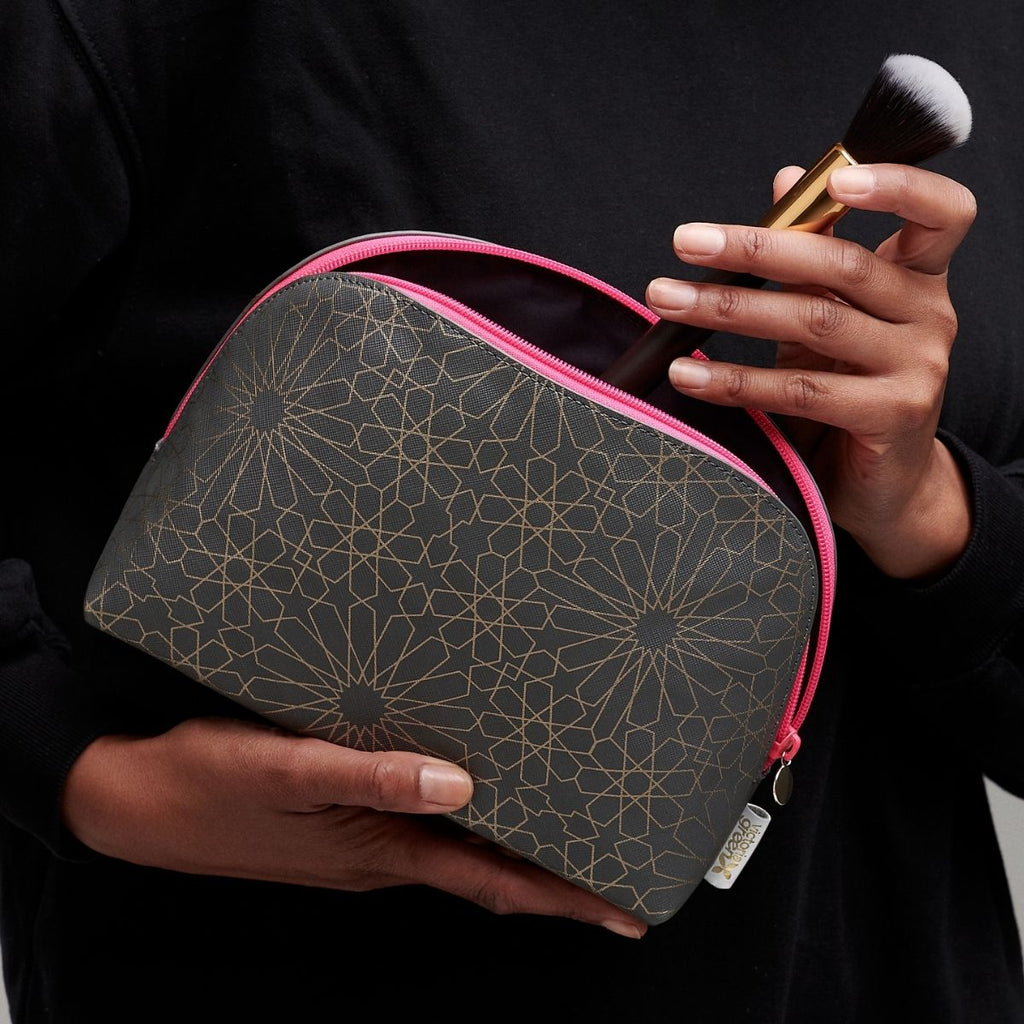 curved large make up bag open with make up brush