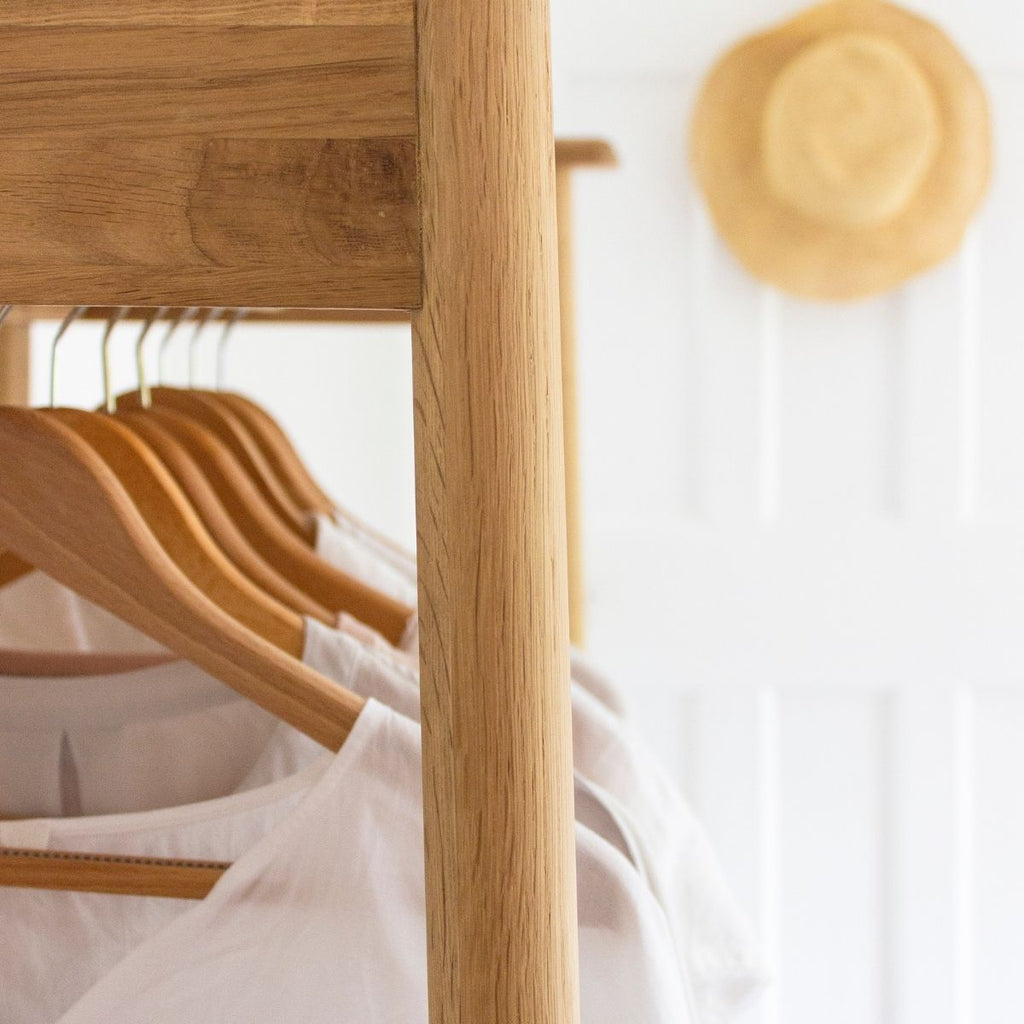 Clothes hanging on wooden clothes hangers for how to get organised this month - May