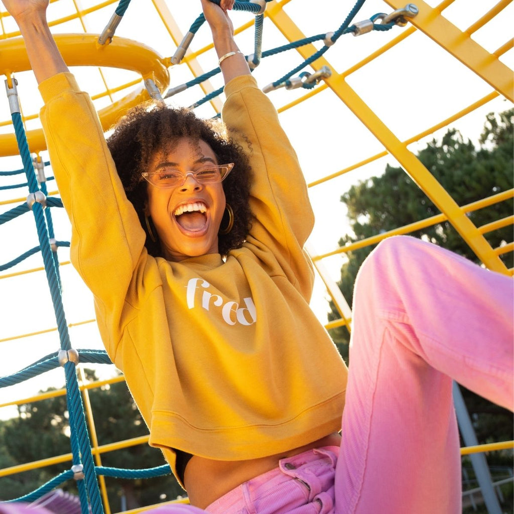 Girl in yellow jumper on climbing frame for how to get organised this month may