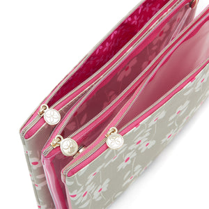 3 piece cosmetic bag set with zip fastenings at top of pouches