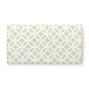 Reverse of makeup brush case in green geometric pattern