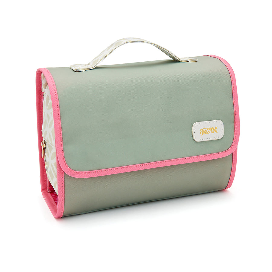 Hanging wash bag in green colour with pink trim and handle
